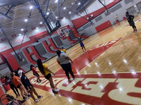 Members of the girls basketball team practice in Alton High