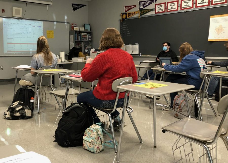 Students sit six feet apart with masks on in Mrs. Lauschke's Honors Pre Calc class after returning to hybrid learning on Jan. 19.