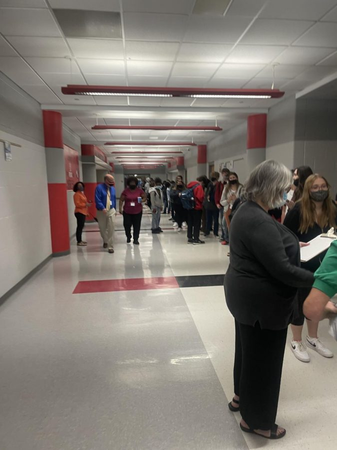 Students wait to sign out  at the attendance office at 11:40 a.m.